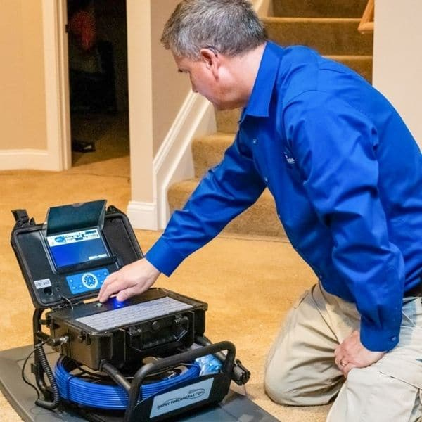 Home Inspector Using Sewer Inspection Camera